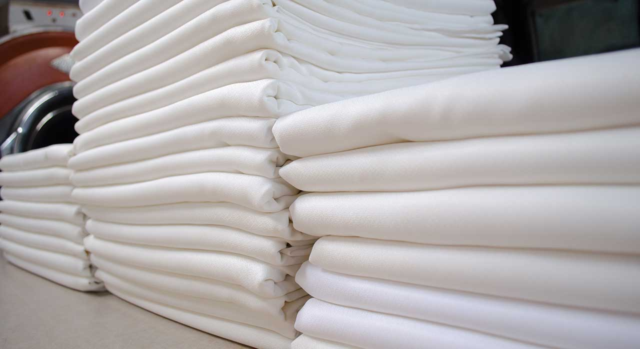 folded_white_laundry_pile
